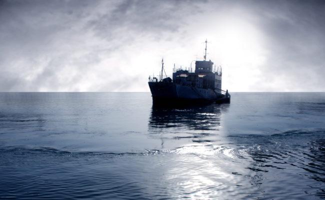 cargo ship sailing ocean